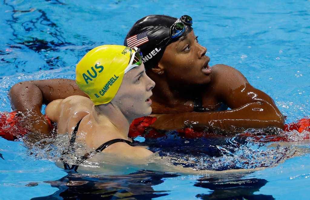 Simone Manuel, right, looks at the scoreboard with Australia's Bronte Campbell after Manuel set a new Olympic record in the women's 100-meter freestyle in Rio de Janeiro, Brazil.