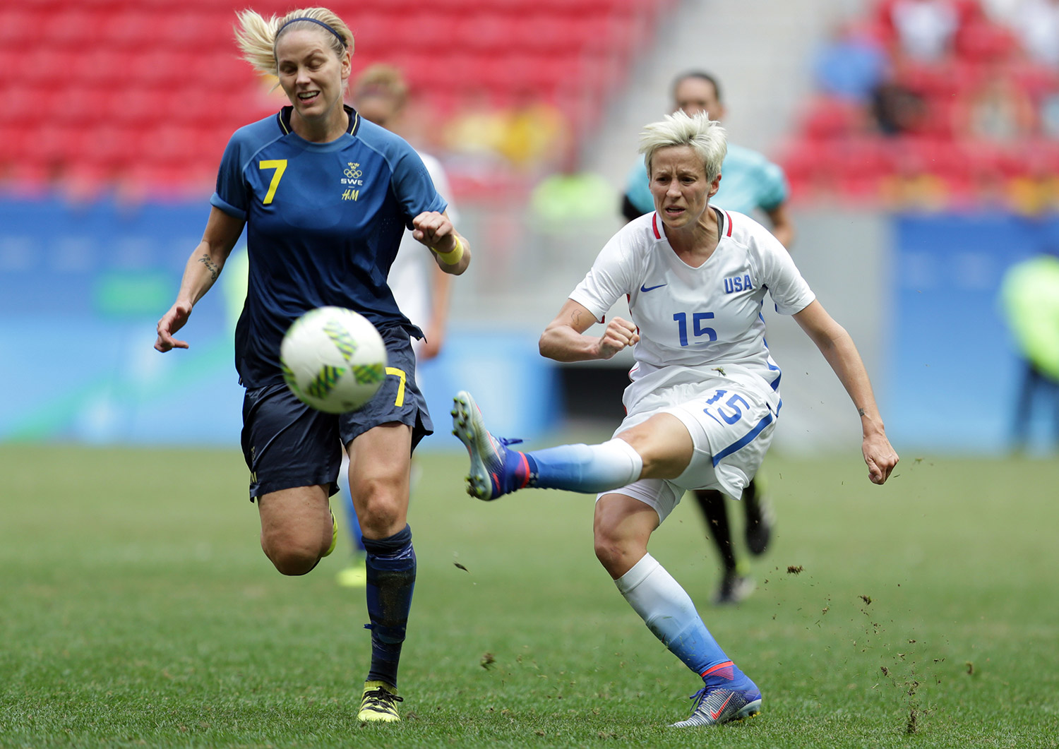 United States' Megan Rapinoe kicks the ball past Sweden's Lisa Dahlkvist during a quarterfinal Olympic soccer match in Brasilia on Friday. The United States lost in a shootout.