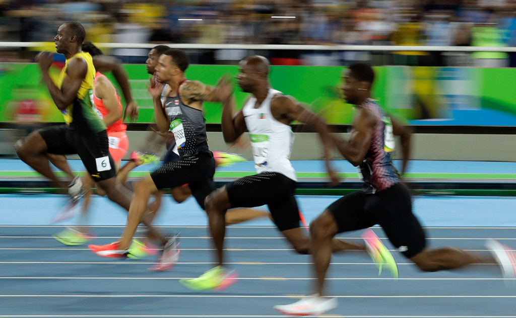 Jamaica's Usain Bolt, left, takes the lead in a men's 100-meter semifinal during the athletics competitions of the 2016 Summer Olympics at the Olympic stadium in Rio de Janeiro, Brazil, Sunday.