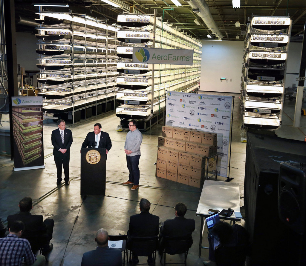 New Jersey Gov. Chris Christie, center at podium, addresses a March 24 gathering at AeroFarms, a vertical farming operation in Newark.