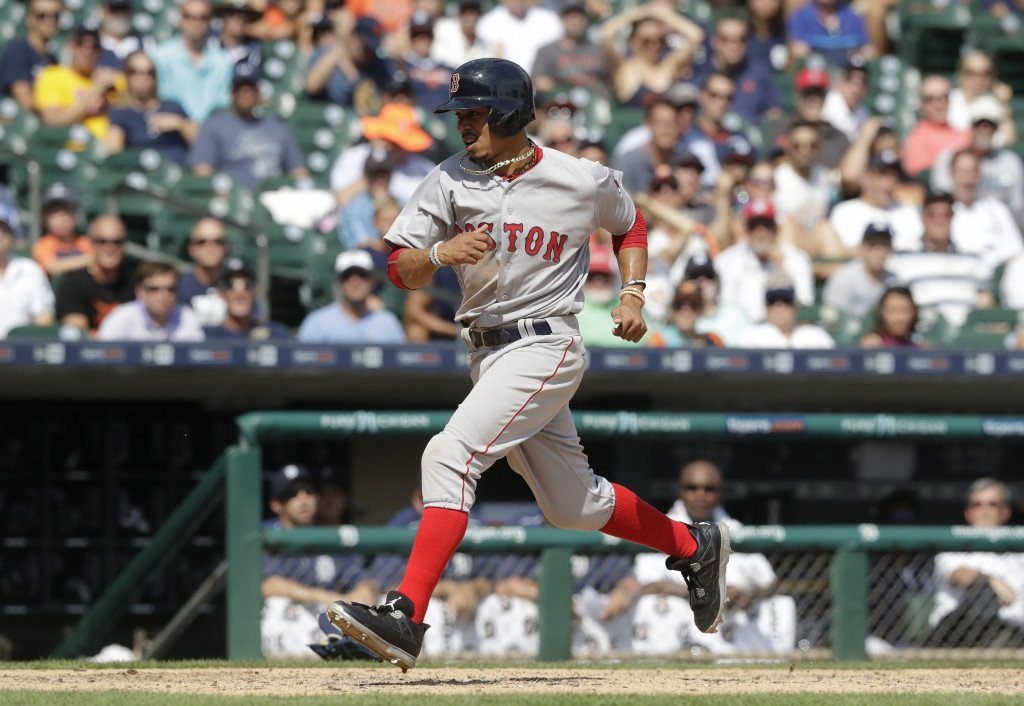 Boston's Mookie Betts scores on a wild pitch during the eighth inning against the Tigers on Thursday in Detroit. Associated Press/Carlos Osorio