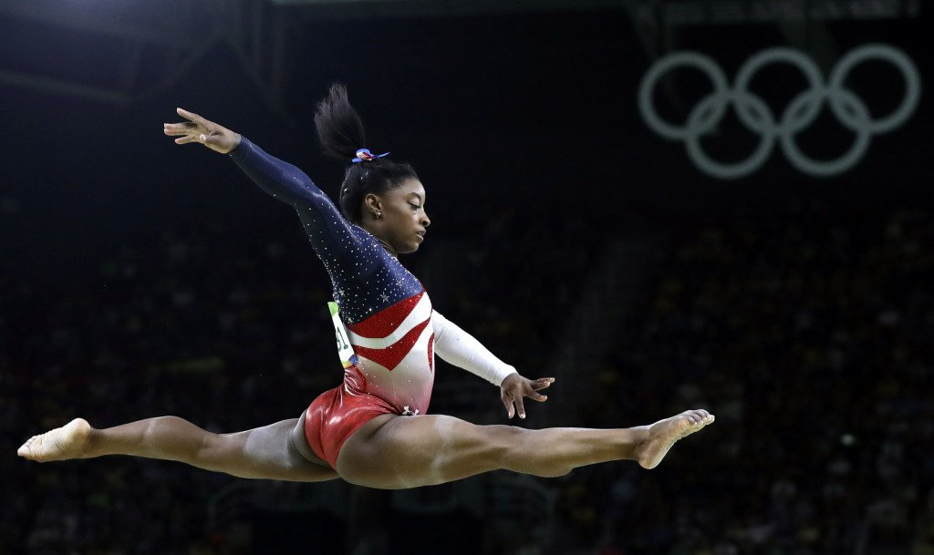 Simone Biles performs on the balance beam during the gymnastics women's team final.    Associated Press/Rebecca Blackwell