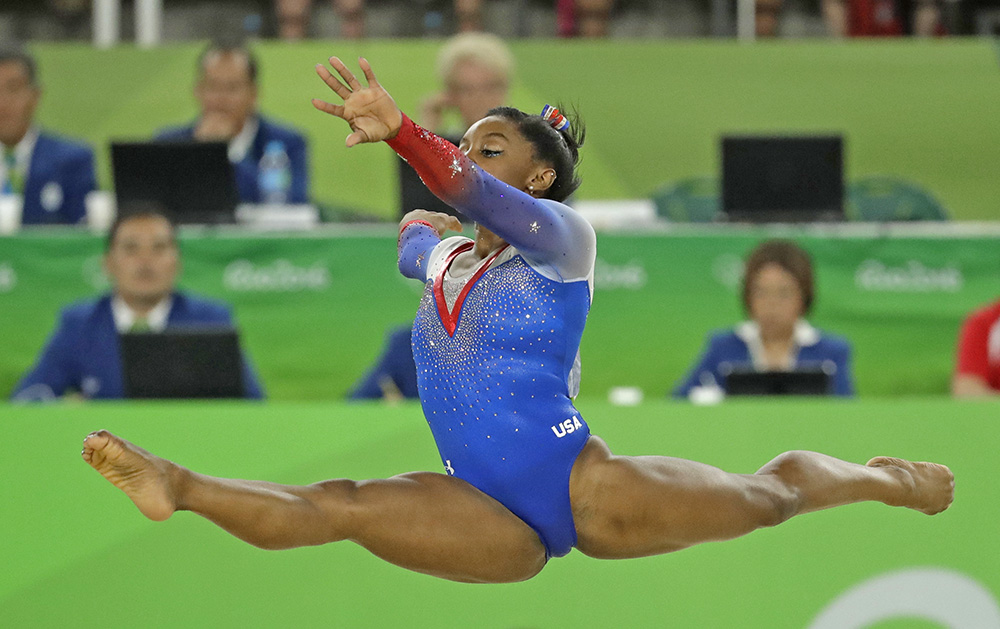 United States' Simone Biles performs on the floor during the artistic gymnastics women's apparatus final at the 2016 Summer Olympics in Rio de Janeiro, Brazil, Tuesday, Aug. 16, 2016. (AP Photo/Dmitri Lovetsky)