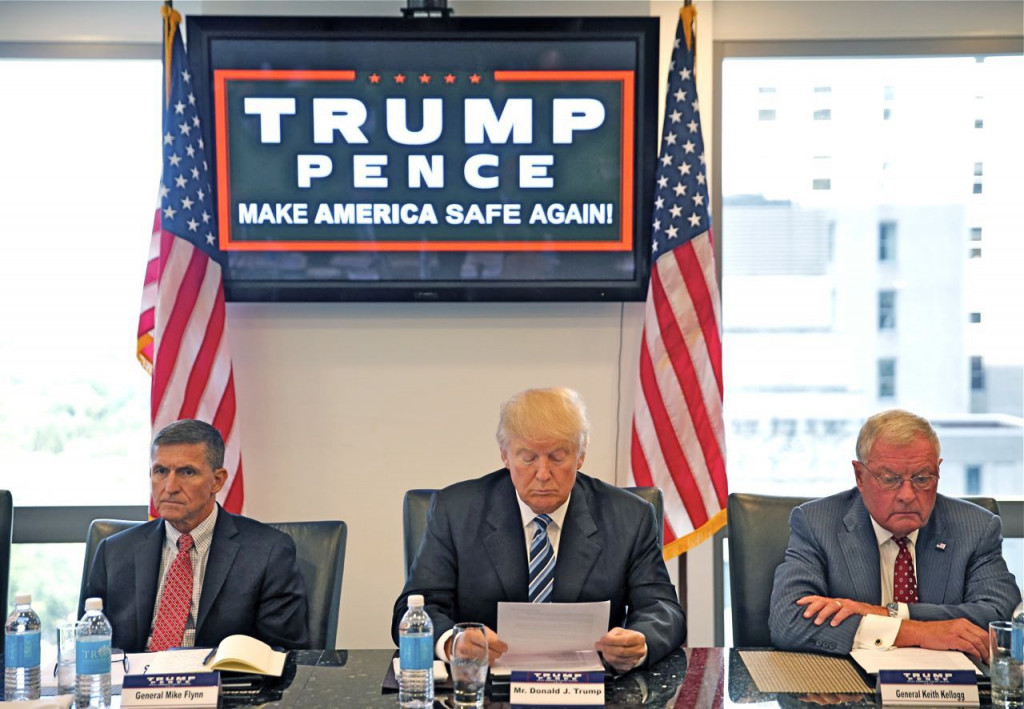 Republican presidential candidate Donald Trump conducts a roundtable discussion on national security in his offices in Trump Tower in New York, Wednesday. Left is Ret. Army Gen. Mike Flynn and right is Ret. Army Lt. Gen. Keith Kellogg. Gerald Herbert/Associated Press