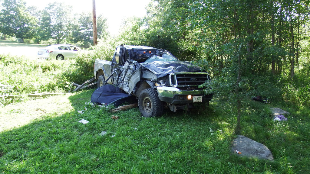 A truck lies on the side of the road in Eliot after a crash on Friday.  Eliot Police Department photo