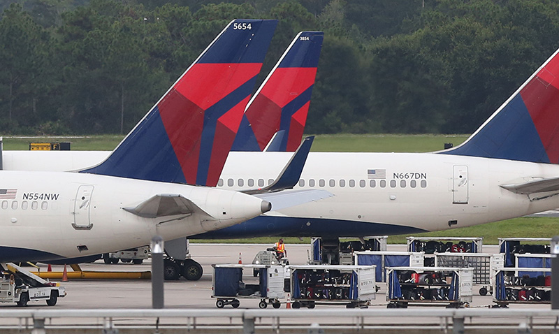 Luggage sits on the tarmac in Florida as a computer outage stranded passengers for several days.