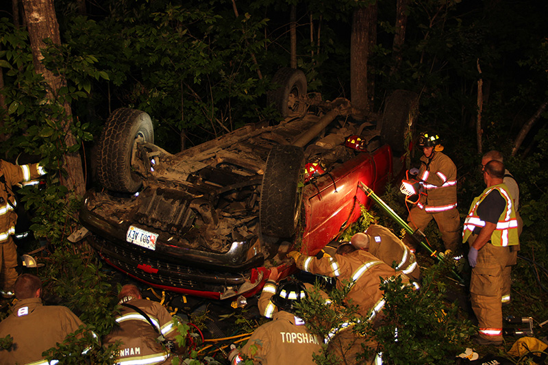 Scene of a crash in Bowdoin Wednesday night that injured the driver and two passengers. The pickup truck overturned off Rte. 138.