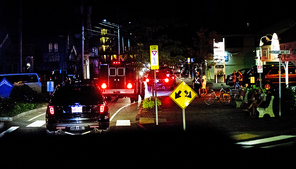 President Barack Obama's motorcade leaves Lola's, a Southern seafood restaurant in Oak Bluffs, Mass., on Martha's Vineyard, and cruises to the usually crowded downtown street early Monday after a first family late night social event with friends. Manuel Balce/Associated Press