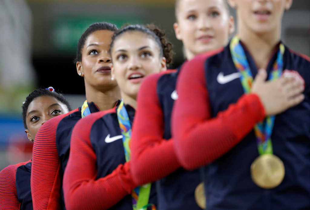 U.S. gymnasts, left to right, Simone Biles, Gabrielle Douglas, Lauren Hernandez, Madison Kocian and Aly Raisman stand for their national anthem Tuesday during the medal ceremony for the artistic gymnastics women's team competition. Associated Press/Julio Cortez