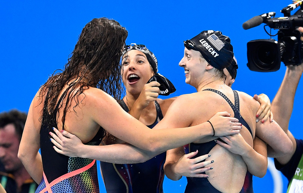Katie Ledecky, right, celebrates with her U.S. teammates Allison Schmitt, Maya DiRado and Leah Smith, from left, after they won the 4 x 200-meter freestyle relay Wednesday night. Ledecky picked up her third gold medal of the Rio Games. Associated Press/Martin Meissner
