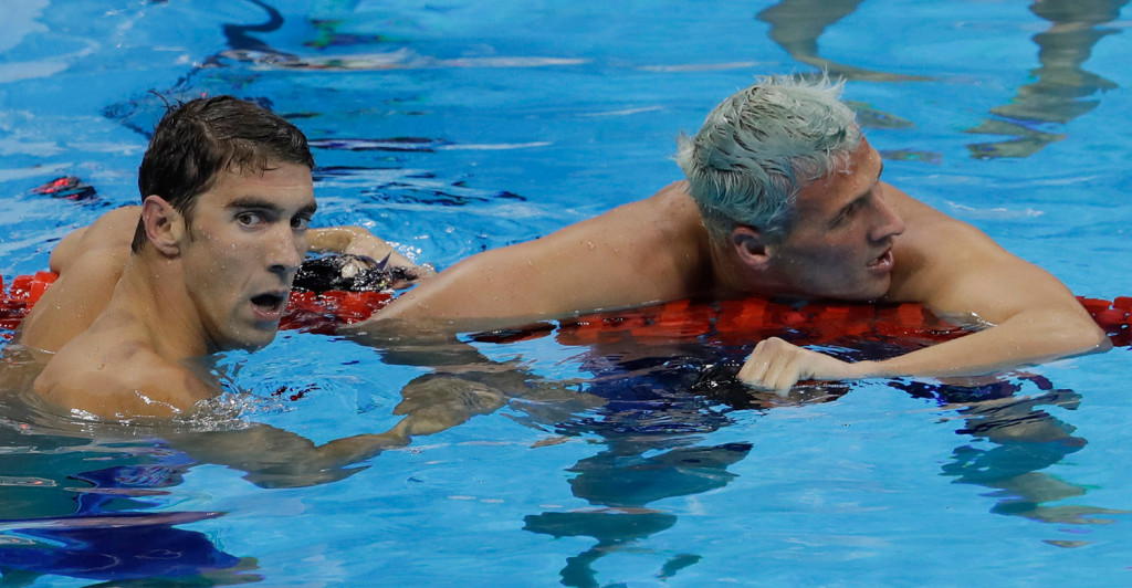 Michael Phelps, left, joins up with U.S. teammate Ryan Lochte after winning the gold medal Thursday night in the men's 200-meter individual medley. Lochte finished fifth.