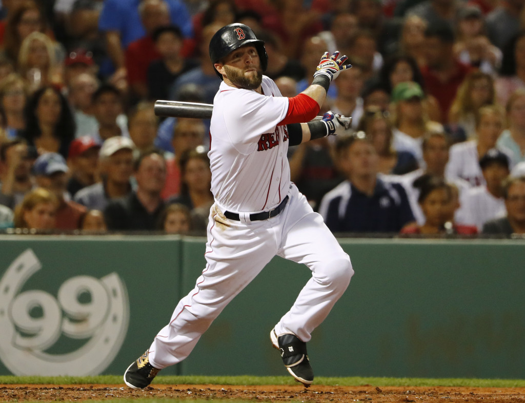 Boston's Dustin Pedroia follows through on his two-run double against the New York Yankees on Tuesday.     Associated Press/Winslow Townson