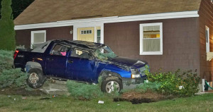 Shane McAlister is accused of crashing this SUV into a house in Yarmouth after a police chase on Aug. 26. He then fled. Contributed photo by Tom Bell