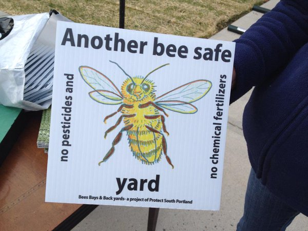 A sign encouraging people to stop using pesticides was posted outside South Portland City Hall in June. The City Council on Monday showed its support for a revised, penalty-free version of a so-called cosmetic pesticide ban.
