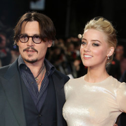 Amber Heard announced Tuesday she would donate proceeds from her divorce to Johnny Depp as she agreed to drop an abuse charge.    Associated Press/Joel Ryan