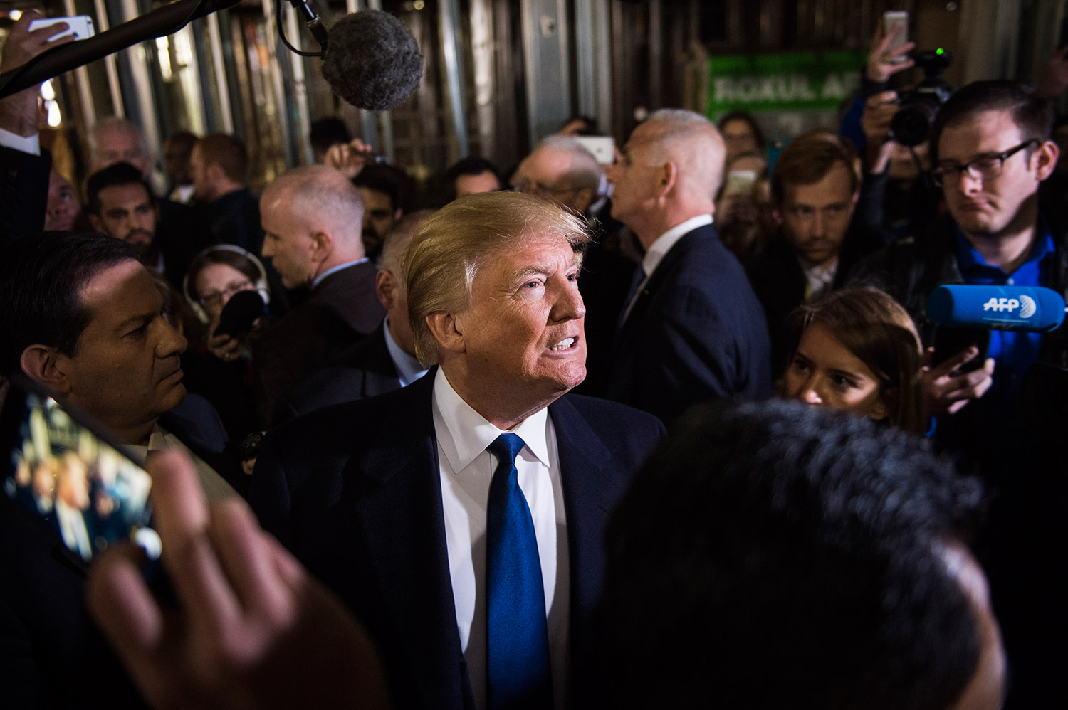 Donald Trump leads reporters on a tour after a news conference at the Old Post Office Pavilion, soon to be a Trump International Hotel, in Washington on March 21.