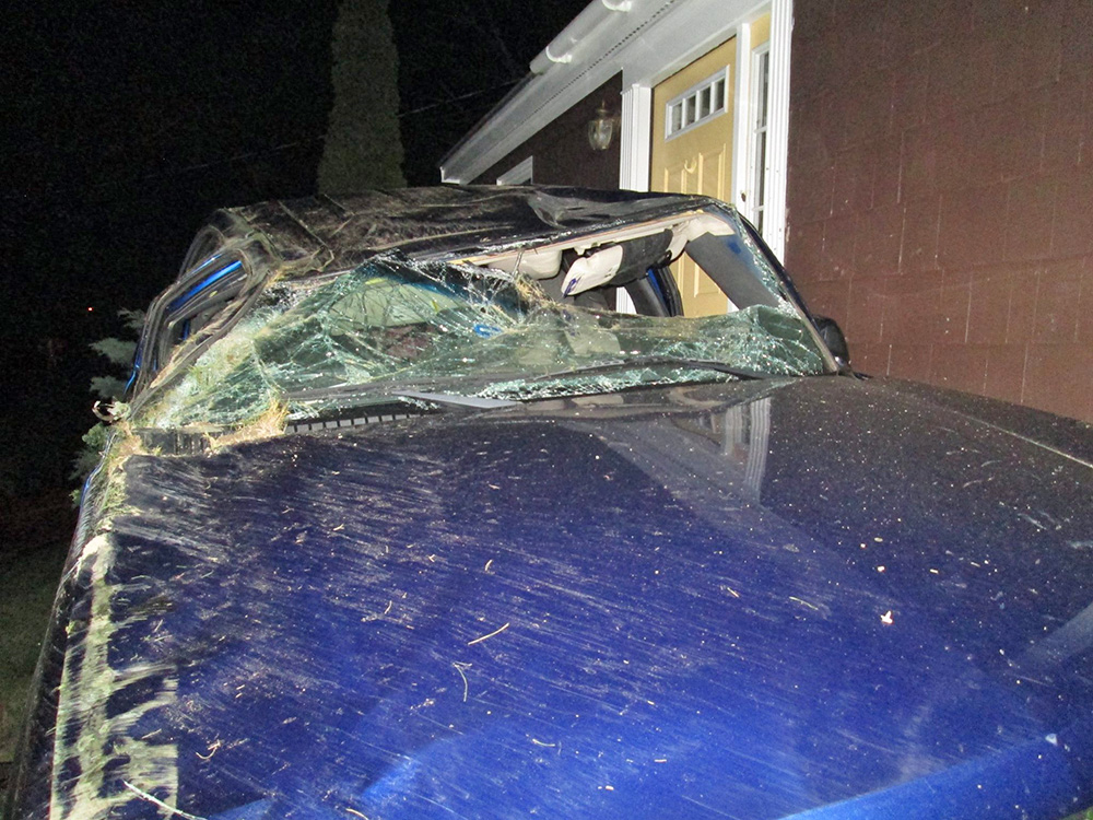 The stolen SUV received extensive damage in Friday night's crash. Photo posted by Yarmouth Police Department on Facebook