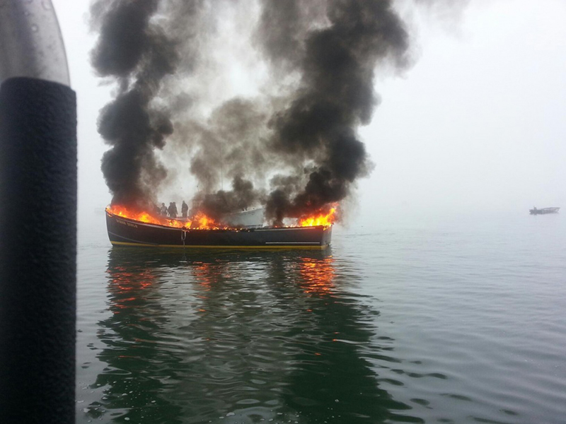 Fishing vessel Bigger Dirls on fire in Hopkins Point Marina.