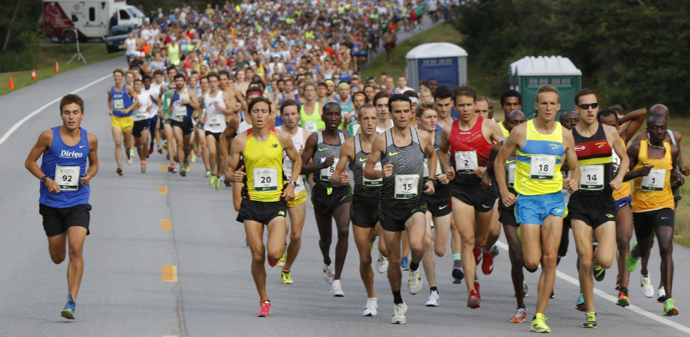 Luke Laverdiere, left, went out with the elite runners at this year's Beach to Beacon 10K in Cape Elizabeth on Aug. 6, then settled in to finish 134th in 36 minutes, 36 seconds.