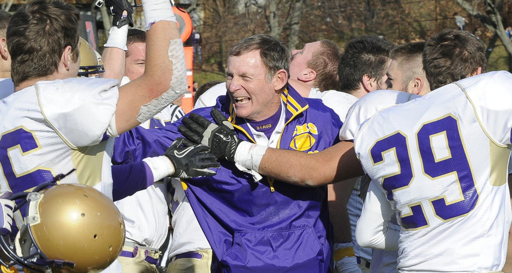 John Wolfgram's football teams won 10 state titles in 40 years, his final two with Cheverus, including this celebration with his players after defeating Lawrence 49-7 in 2011.