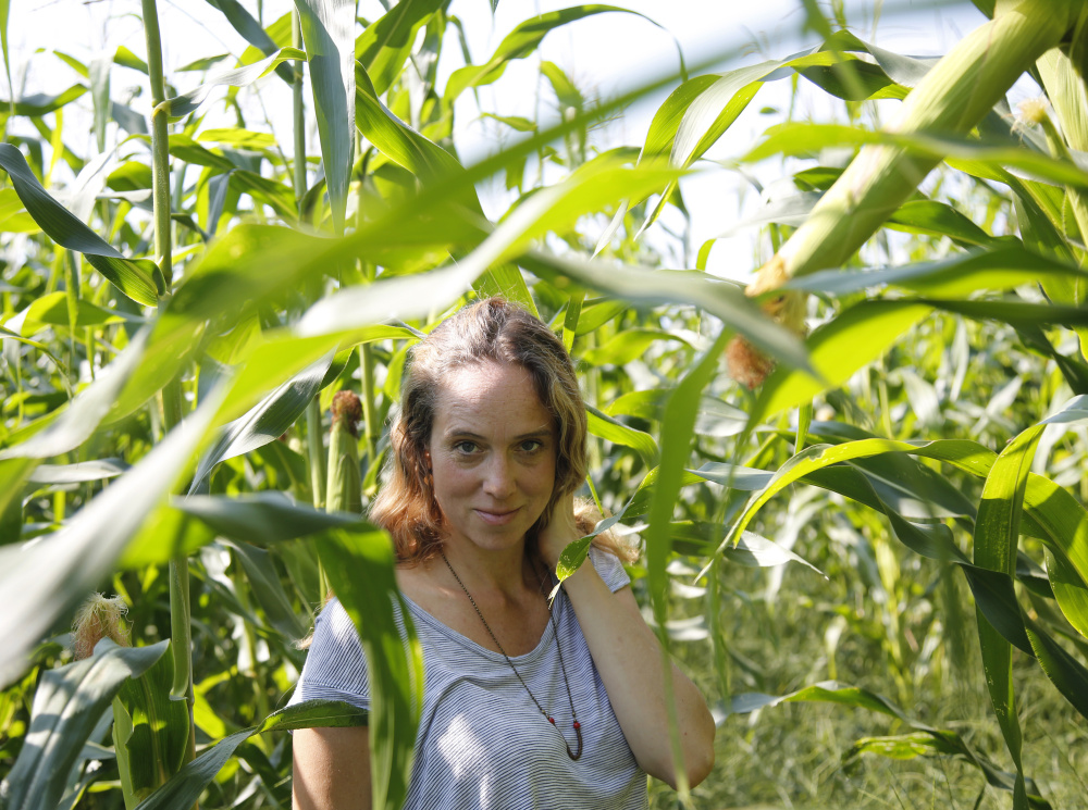 Author Caitlin Shetterly at a corn field in Freeport.  Derek Davis/Staff Photographer