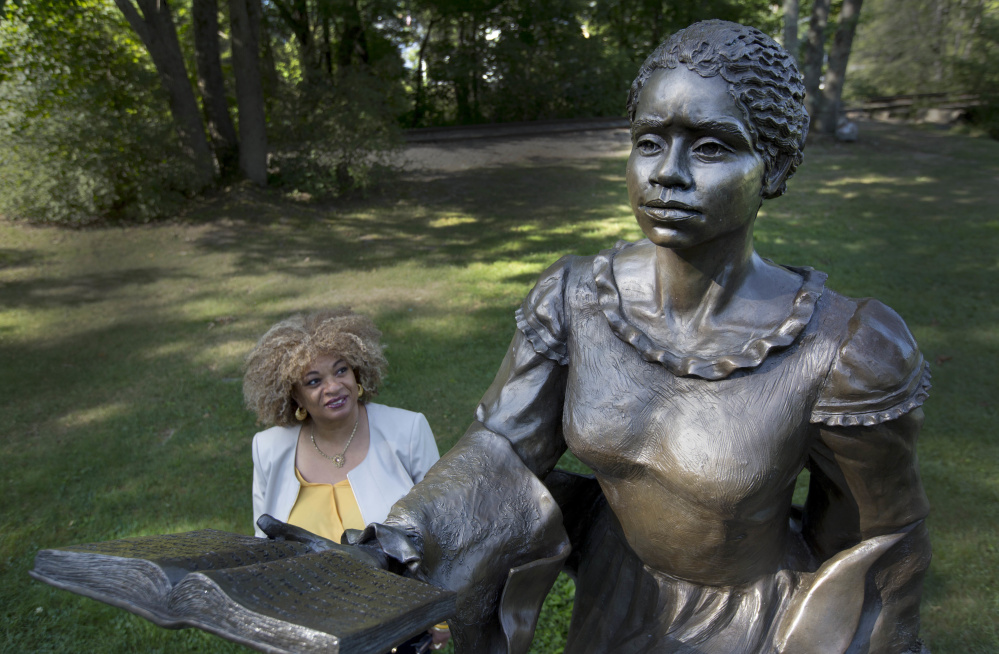 JerriAnne Boggis stands next to a statue of Harriet Wilson in Milford, N.H. Boggis is part of a group of scholars working on what they hope will be a statewide, black history trail.