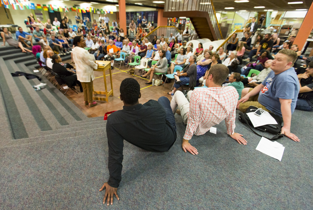 About 150 people attended Thursday night's forum at the Reiche elementary school, where panelists told the audience that it can be challenging to be a black person living in a predominately white state.