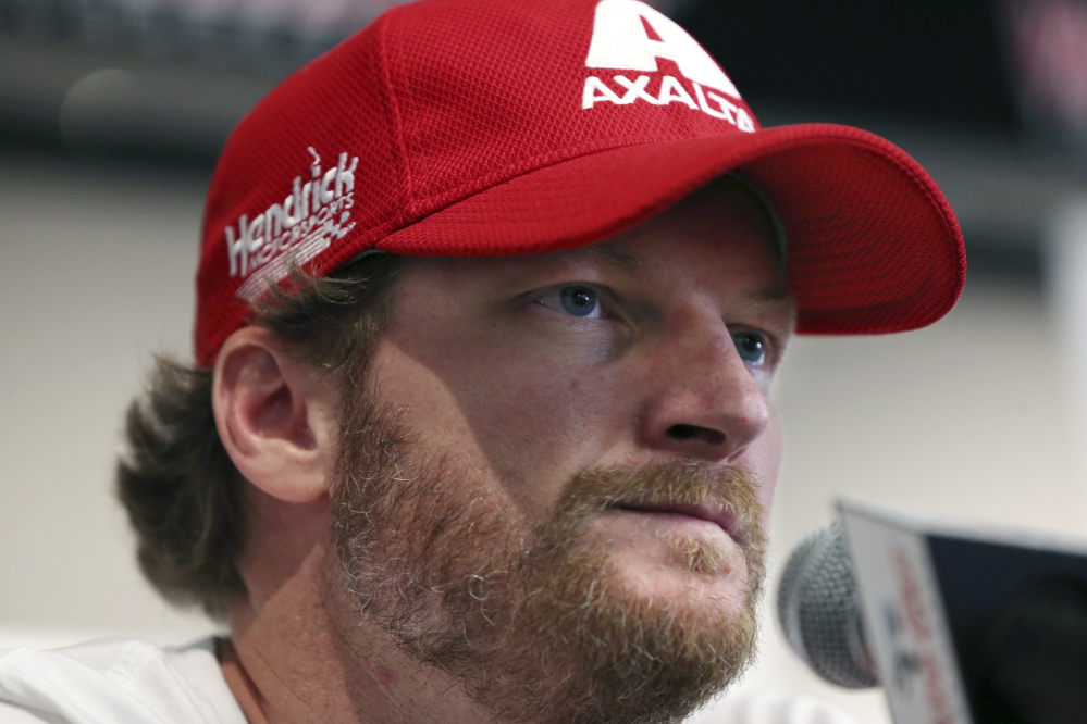 Dale Earnhardt Jr., shown on Aug. 5 addressing the media, will miss the rest of the NASCAR season as he continues to recover from a concussion.