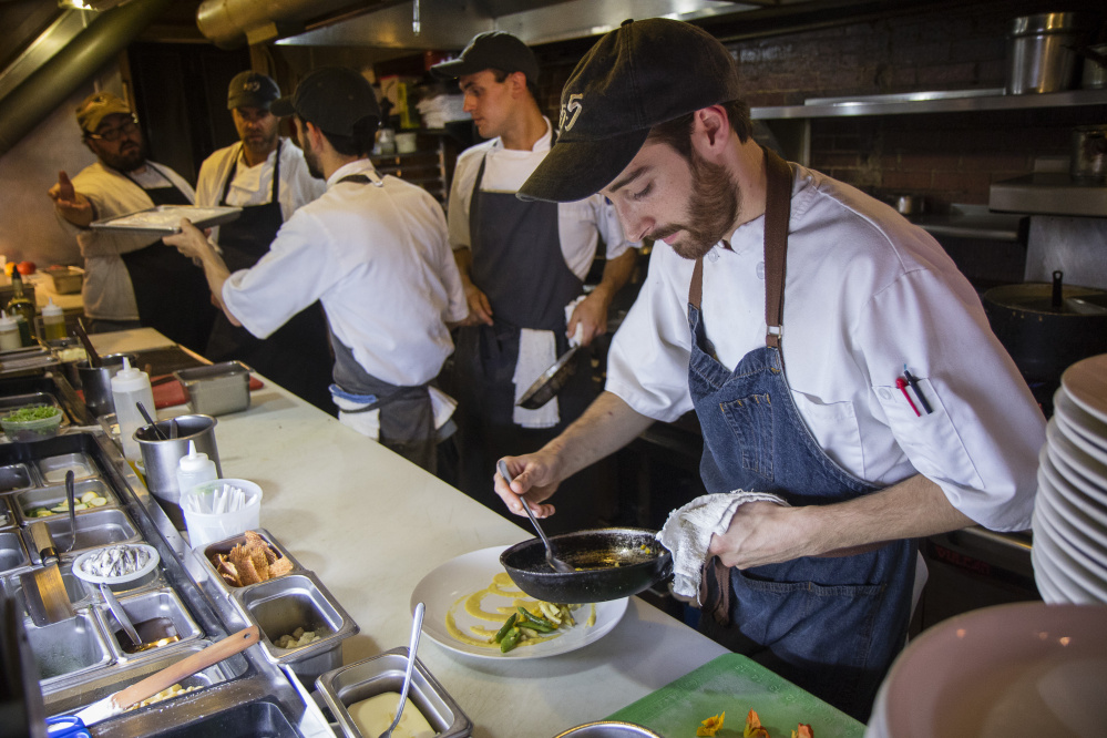 The kitchen is typically hopping at Five-Fifty-Five.