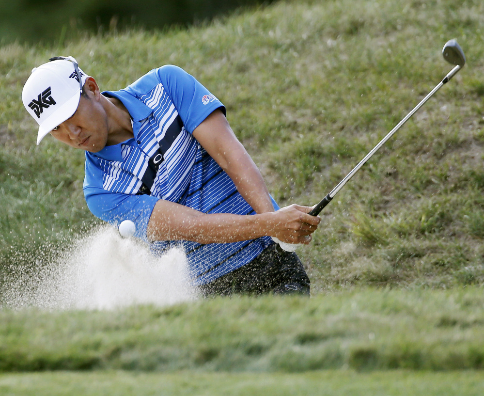 Co-leader James Hahn hits from a bunker to the eighth green during the first round of the Deutsche Bank Championship on Friday in Norton, Mass.