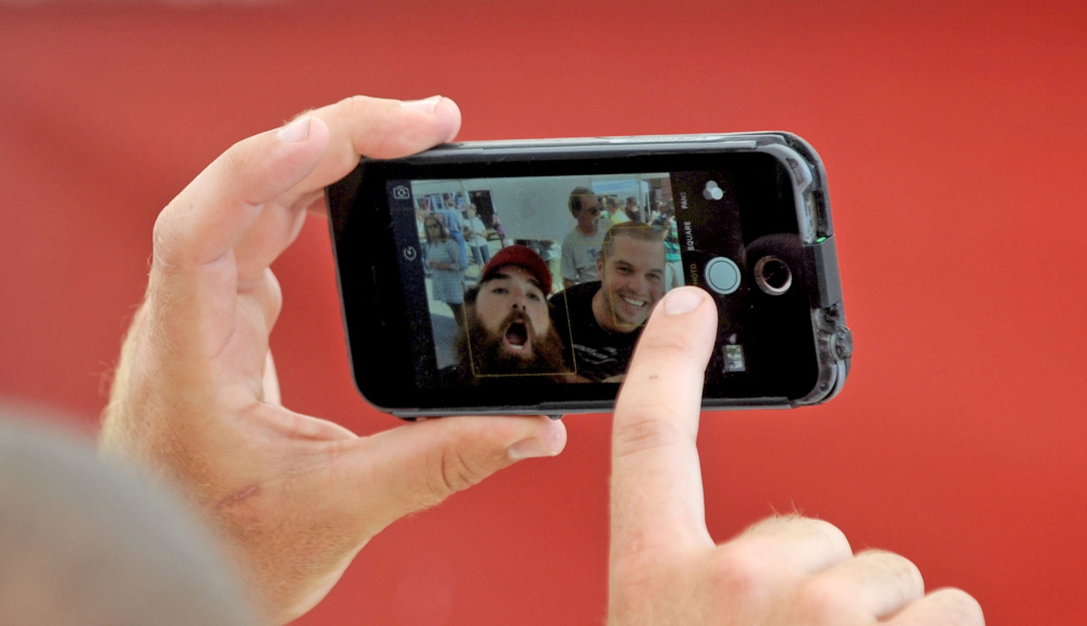 Andrew Geaghan of Geaghan Brothers Brewing snaps a selfie with a festivalgoer Saturday.