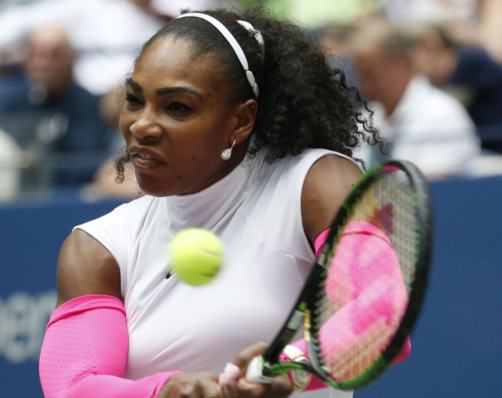 Serena Williams returns a shot to Johanna Larsson of Sweden while advancing Saturday to the fourth round of the U.S. Open with a 6-1, 6-1 victory.