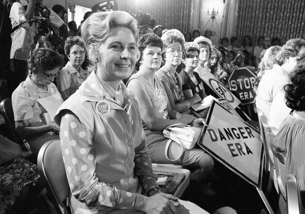 Women opposed to the Equal Rights Amendment sit with Phyllis Schlafly, left, national chair of Stop ERA, at a hearing of a Republican platform subcommittee on Aug. 10, 1976, in Kansas City, Mo. Schlafly helped defeat the Equal Rights Amendment.