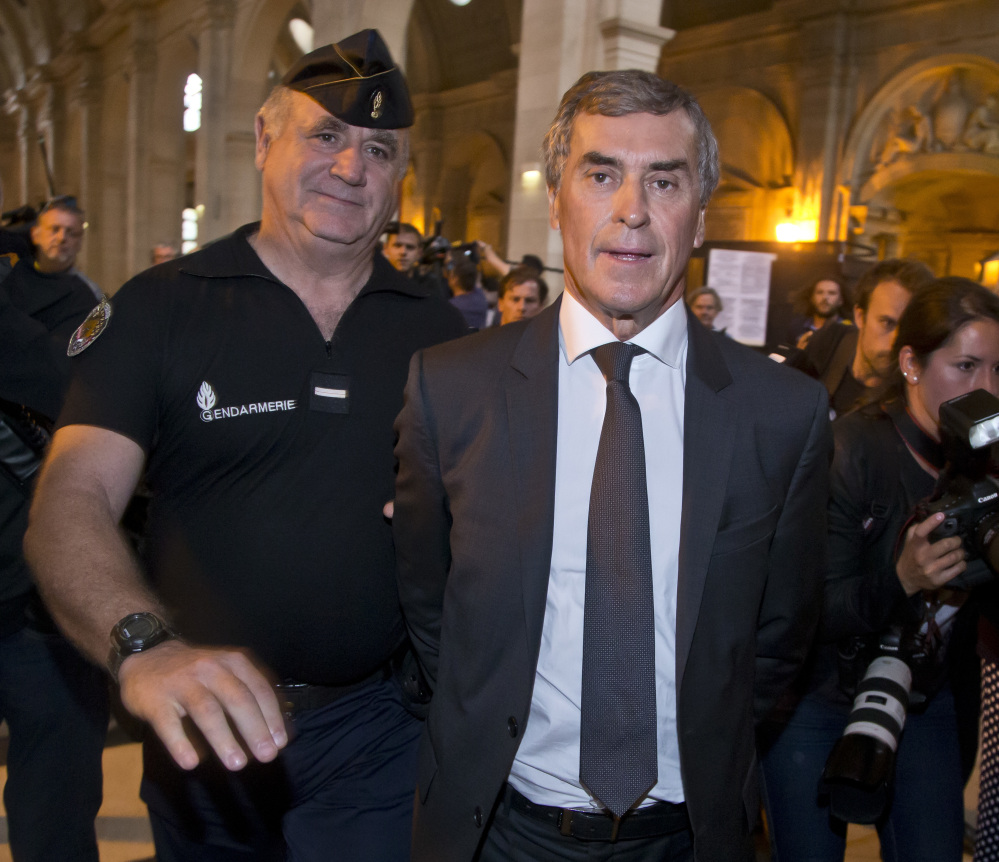Former French Budget Minister Jerome Cahuzac leaves court Monday, charged with hiding part of his wealth in tax havens around the world while fighting tax evasion at home.
