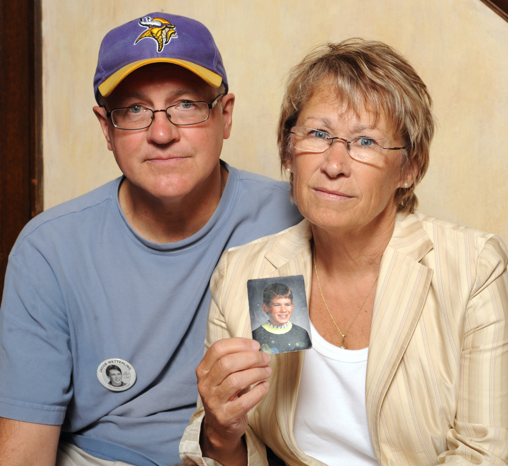 Patty and Jerry Wetterling hold up a photo in 2009 of their son Jacob Wetterling, who was abducted in October of 1989.  Patty Wetterling became a nationally known advocate for missing children.