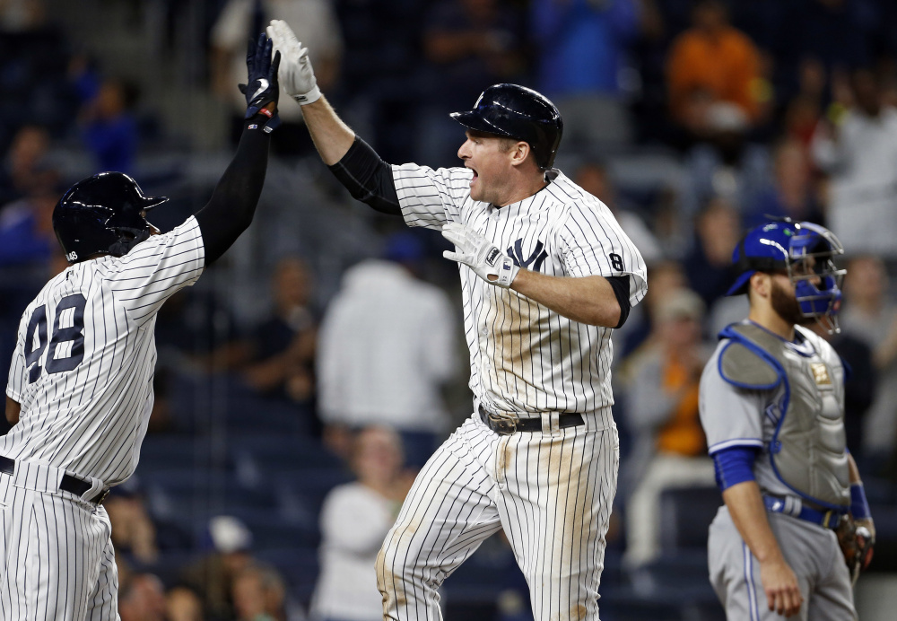 Chase Headley of the New York Yankees celebrates his two-run homer with Eric Young Jr. during the eighth inning of a 7-6 win by the Yankees at New York on Tuesday.