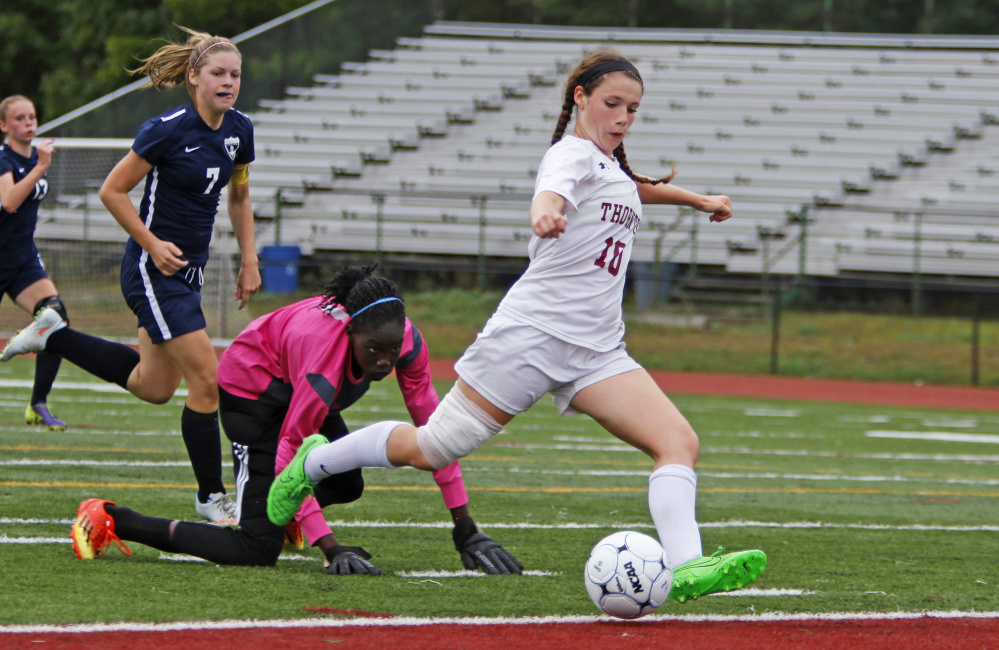 Hannah Niles of Thornton Academy breaks through to score her second goal in a three-minute span during the second half Wednesday, getting past Reilley Joyce and goalie Nyagoa Bayak of Westbrook during Thornton's 3-0 victory in girls' soccer at Saco.