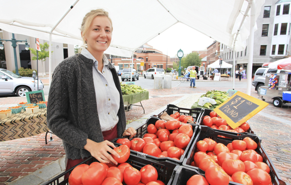 Grace Pease of Merrifield Farm in Cornish with fresh tomatoes from her farm selling for $1 a pound at the Portland Farmers' Market.