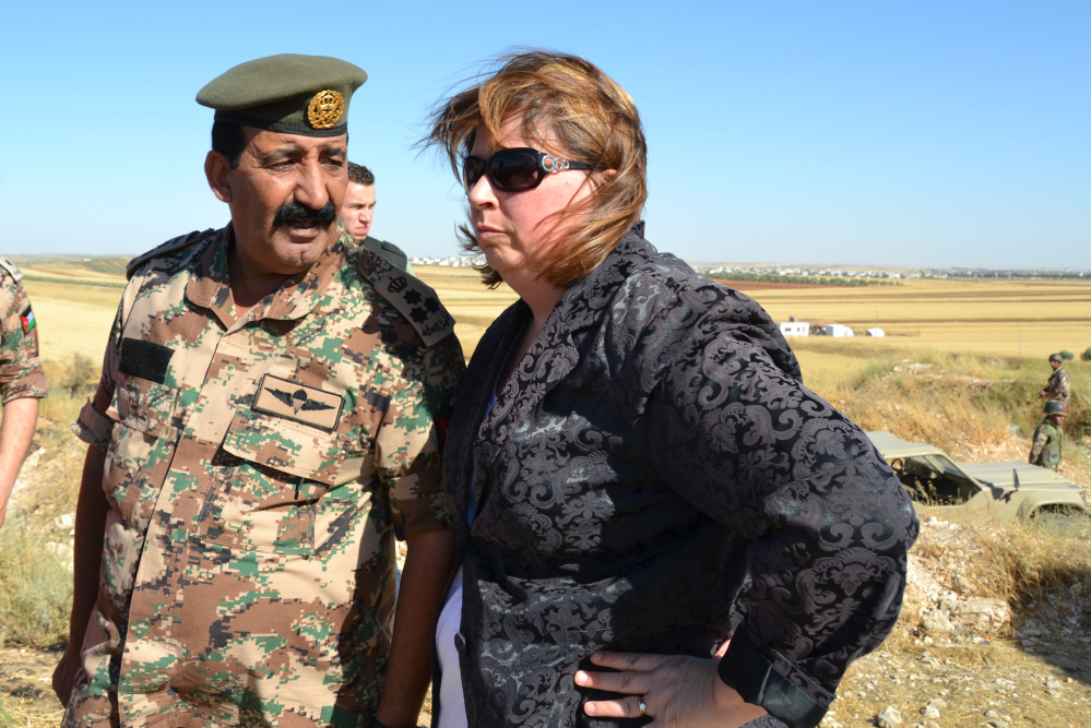 Crystal Canney, then an aide to Sen. Angus King, and a Jordanian military leader talk during a 2013 congressional trip. It was in Jordan, Canney says, that she began to realize the scope of the humanitarian crisis caused by the civil war in Syria.