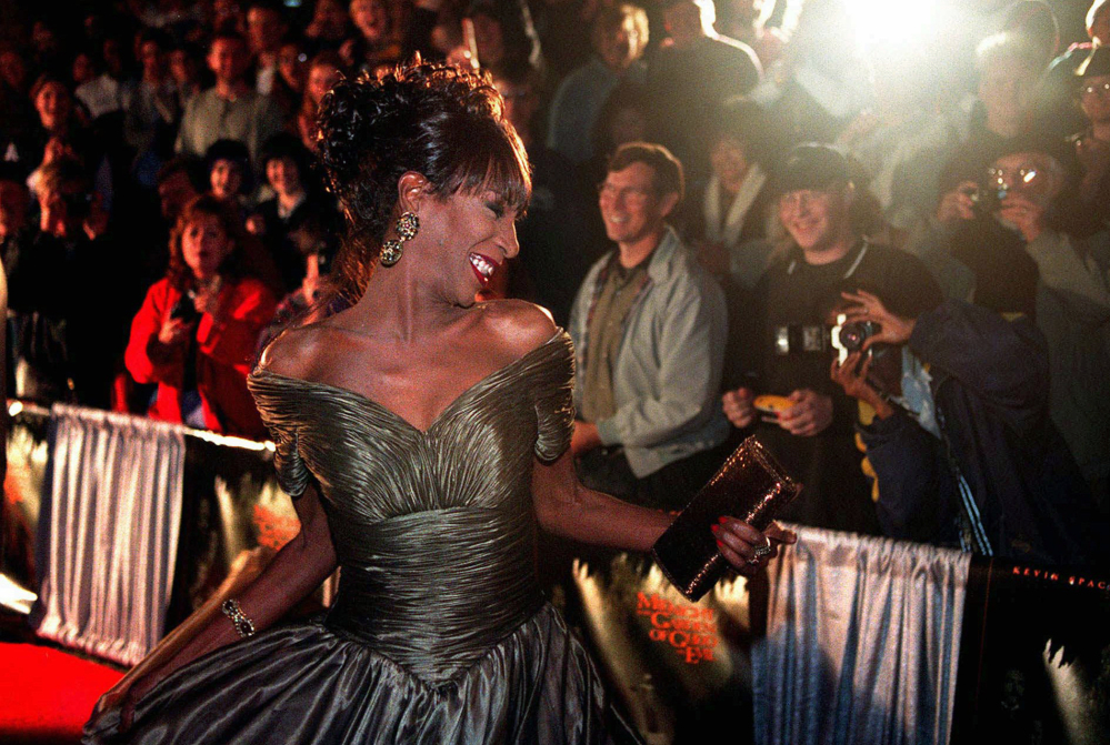 The Lady Chablis twirls for the crowd at the November 1997 premier of the movie