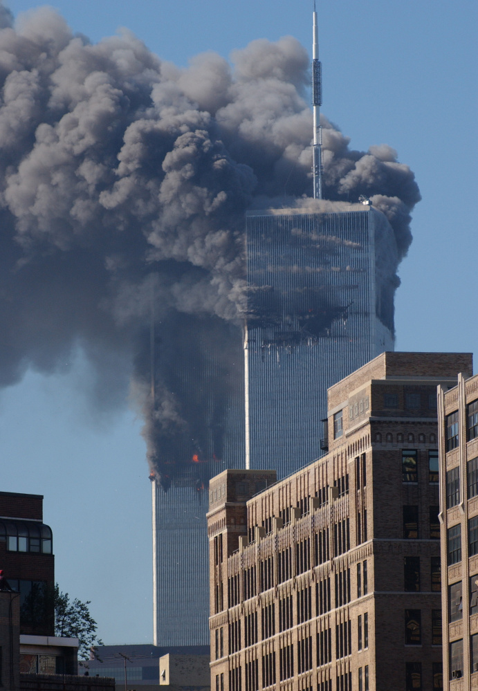 The South Tower of the World Trade Center's twin towers begins to collapse after a hijacked plane crashed into it on Sept. 11, 2001 in New York City. The attack changed the world forever.