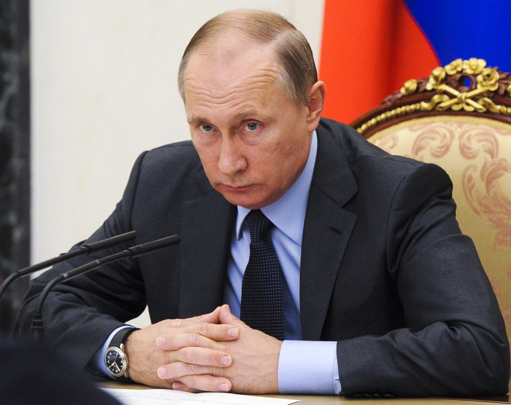 Russian President Vladimir Putin holds a Cabinet meeting Wednesday in Moscow's Kremlin. Recent hacks of election data systems in at least two states have raised fear among lawmakers and intelligence officials that a foreign government is trying to manipulate the presidential race, renewing debate over when cyberattacks warrant a U.S. response.