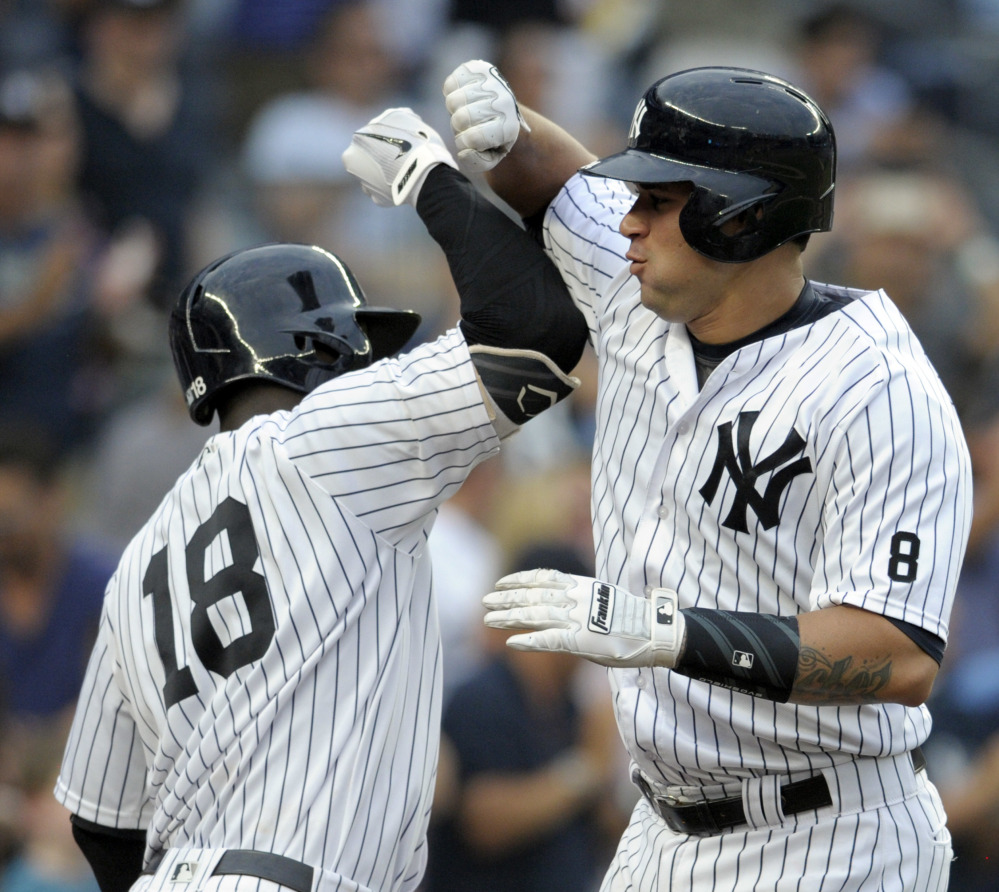 Gary Sanchez, right, celebrates with Didi Gregorius after hitting a home run in the sixth inning of the Yankees' 5-1 victory Saturday against Tampa Bay.