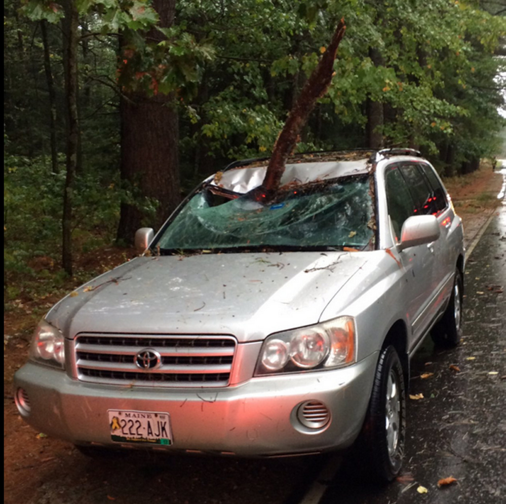 A car shows damage from Sunday's storm.