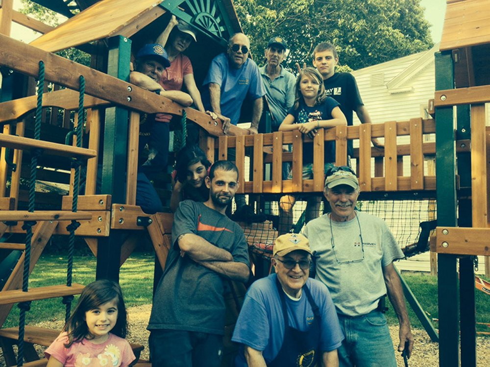 Brunswick Rotary Club members recently donated and assembled a new playset at the Tedford Housing emergency family shelter.