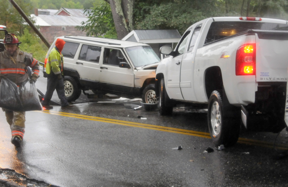 Responders investigate the cause of an accident Sunday morning on Litchfield's Hallowell Road that sent four people to the hospital with non-life-threatening injuries.