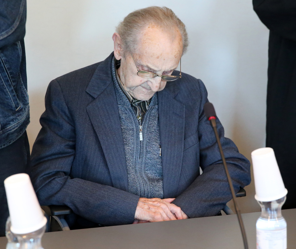 Former SS medic Hubert Zafke, who served at the Auschwitz death camp, sits in a courtroom ahead of his trial in Neubrandenburg, eastern Germany, on Monday.