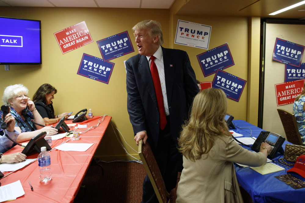 Republican presidential nominee Donald Trump visits a call center before the start of a rally Monday in Asheville, N.C.