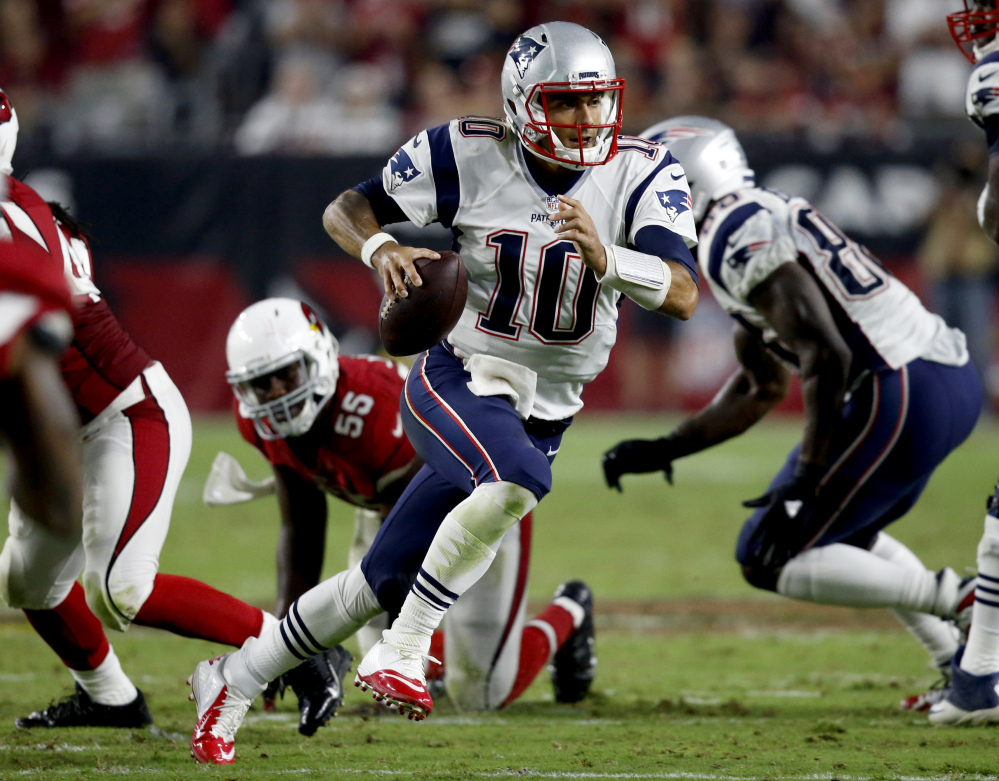 New England Patriots quarterback Jimmy Garoppolo scrambles against the Cardinals during the second half Sunday in Glendale, Ariz. Associated Press/Ross D. Franklin