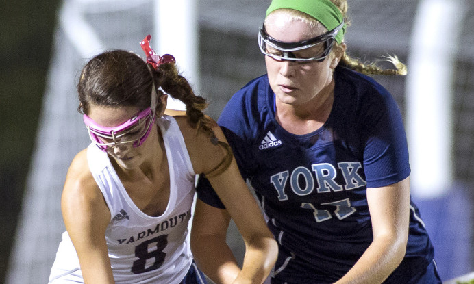 Yarmouth senior Abby McDowell, left, runs with the ball as York sophomore Emlyn Patry attempts to steal it Monday at Yarmouth High School. York High won 3-1. .